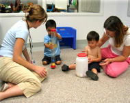 student clinicians with two toddler clients